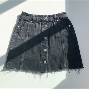 faded black button up front mini skirt